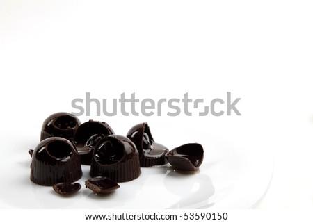 Cherry chocolates isolated on white - stock photo