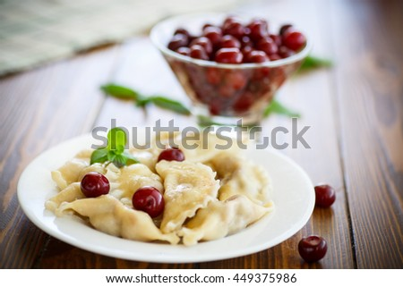 Cherry dumplings with mint - stock photo