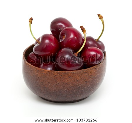 cherry in a bowl isolated on white