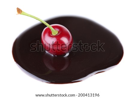 Cherry  in chocolate sauce isolated on white