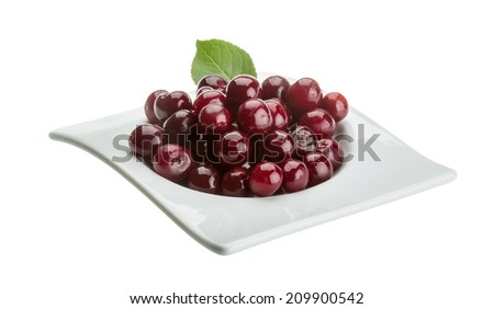 Cherry in the bowl with leaf