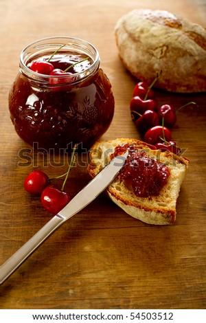 cherry jam aver slice bread - stock photo