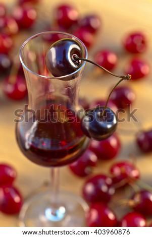 cherry liquor and juicy ripe berries ,shallow DOF - stock photo