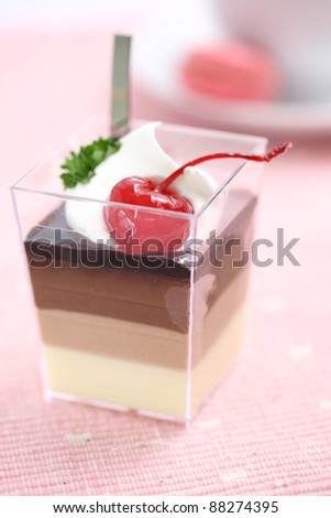 Cherry Panna Cotta pudding with coffee - stock photo
