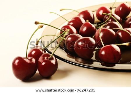 Cherry. Ripe cherries on the plate. - stock photo