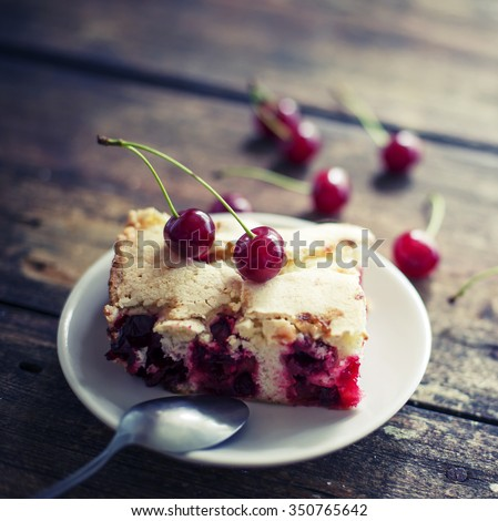 Cherry sponge cake/Cherry cake and slices of cherry cake on rustic wooden background - stock photo