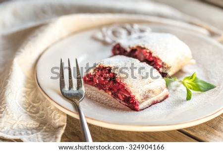 Cherry strudel with fresh mint - stock photo
