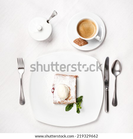 Cherry strudel with ice cream and coffee. Top view. - stock photo