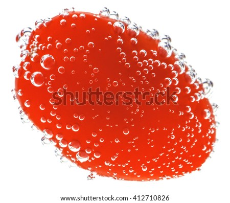 Cherry Tomato with gas bubbles.  Isolated on a white background.  - stock photo