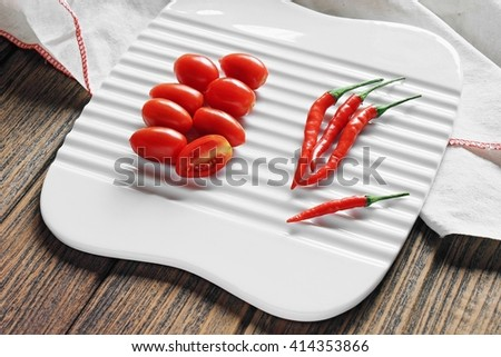 Cherry tomatoes and chilli pepper, Red food, Phytonutrient, Healthy Cuisine ingredients. - stock photo