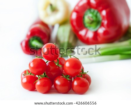 cherry tomatoes and fresh vegetables - stock photo