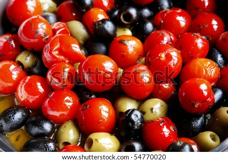 Cherry tomatoes and olives - stock photo