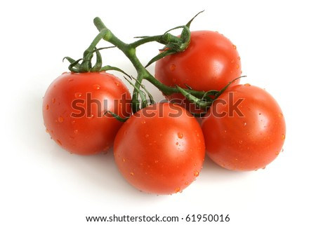 Cherry tomatoes covered drops on a white background - stock photo