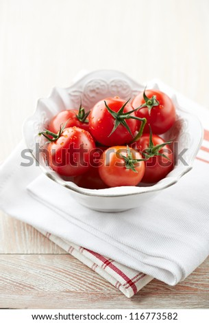 Cherry tomatoes in a bowl - stock photo