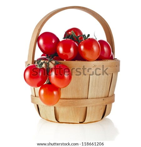 cherry tomatoes in wooden basket on white background - stock photo