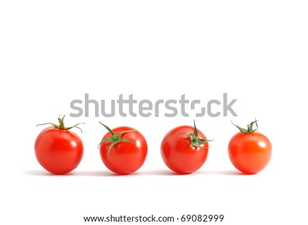 Cherry tomatoes line up! - stock photo
