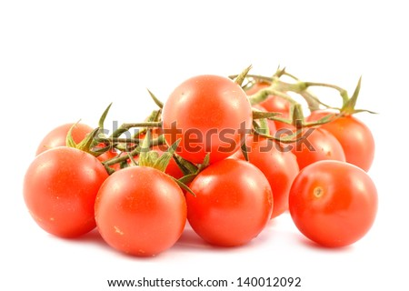 Cherry tomatoes on a branch close-up on white background - stock photo