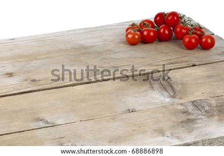 cherry tomatoes on a wooden surface - stock photo