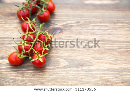 cherry tomatoes on a wooden surface with natural light