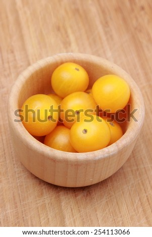 cherry tomatoes over wooden background - stock photo