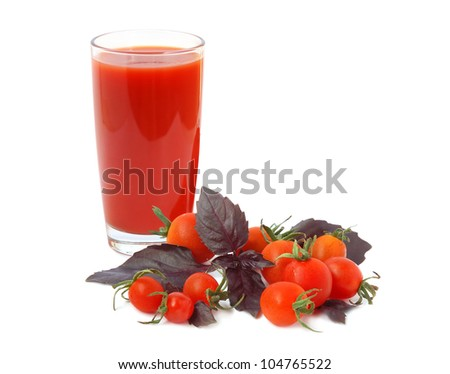 Cherry tomatoes, red basil and glass full of tomato juice - stock photo