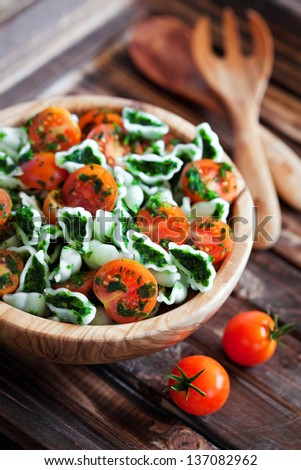Cherry tomatoes with gluten-free pasta and spinach sauce, selective focus - stock photo
