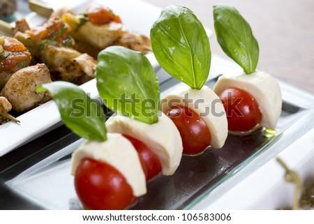 cherry tomatoes with mozzarella / appetizer food - stock photo
