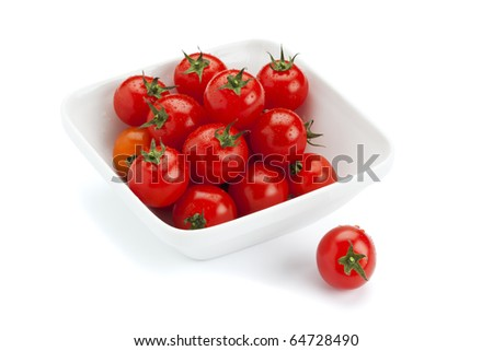 cherry tomatoes with water drops in square bowl, isolated on white background - stock photo