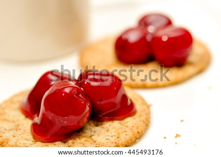 cherry topping on cracker, delicious dessert