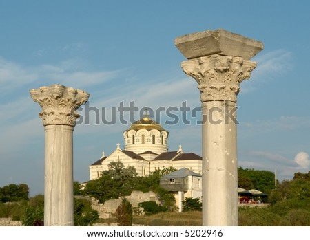 Chersonesos. Ancient Greek columns with orthodox temple at background - stock photo