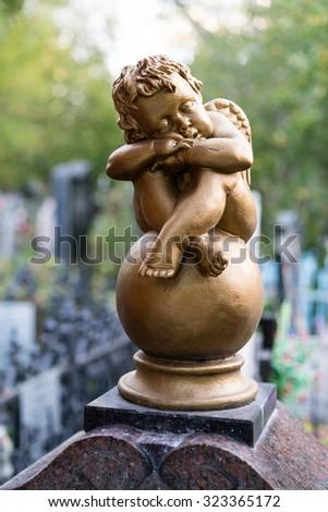 cherub at the cemetery - stock photo