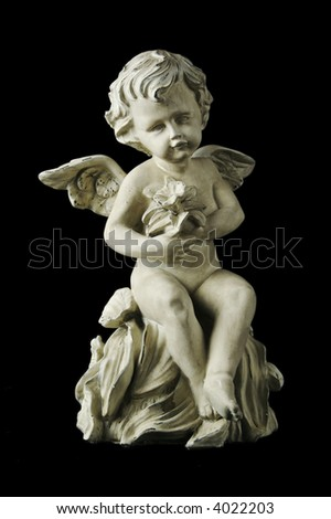Cherub with dramatic side lighting on a black background.
