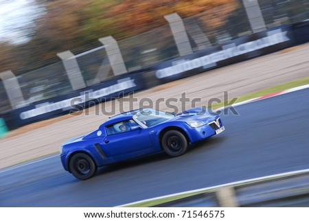 CHESHIRE, ENGLAND - NOVEMBER 12 : Vauxhall VX220 on November 12, 2008 in Cheshire, England, UK. Oulton Park is a Race Track host to Many Automotive Events and Track Test Days - stock photo