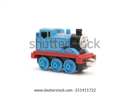 CHESHIRE, UK - February 9 2015. Thomas the Tank Engine toy, based on children's books by the Reverend Wilbert Awdry isolated on white background - stock photo