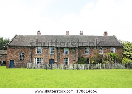CHESHIRE, UK - June 12, 2014: Cottages, Dunham Massey Hall, Altrinham, Cheshire, England, UK, 12 June 2014. The hall is a Grade 1 listed building and supports the National Gardens Scheme charity programme - stock photo