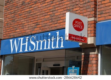 Cheshire, UK - June 4th 2015: WH Smith shops have Post Office counters within them as part of the restructuring by the Post Office.  WH Smiths shop front, logo and sign