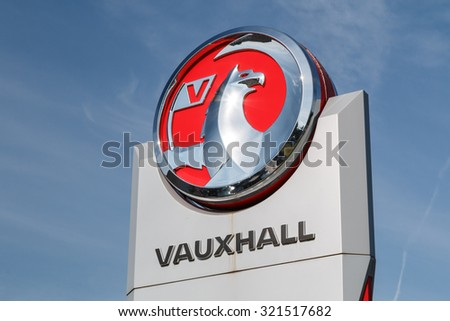 Cheshire,UK - September 28th 2015: Vauxhall logo on a sign outside the car or automotive dealership. All car brands are under scrutiny after the VW emissions scandal. - stock photo