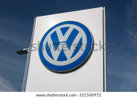 Cheshire,UK - September 28th 2015: VW or Volkswagenlogo on a sign outside the car or automotive dealership. All car brands are under scrutiny after the VW emissions scandal. - stock photo