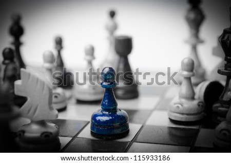 Chess. Alone piece - business concept of lonely worker - stock photo