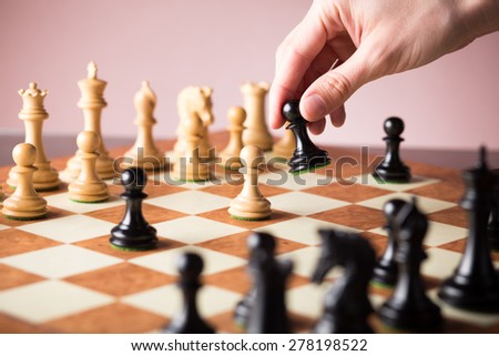 Chess board with chess pieces. Win concept. Making a strategic move. - stock photo