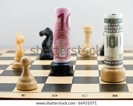 Chess board with figures and american and european union moneys