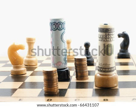 Chess board with figures and russian and american moneys - stock photo