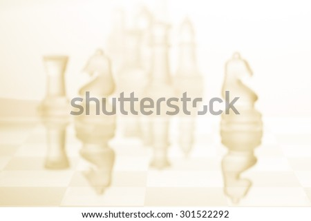 Chess figures blur focus- strategy and teamwork concept - stock photo