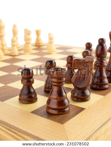 chess figures on board isolated at white background - stock photo