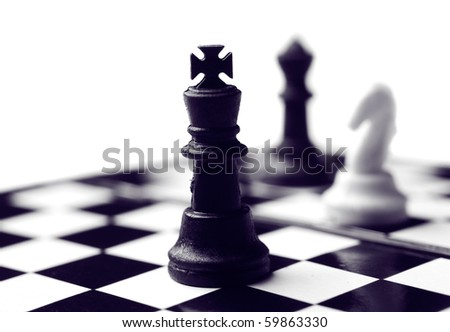 Chess figures on board isolated on white - stock photo