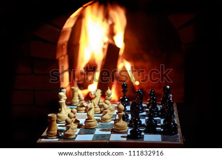 chess fireplace - stock photo