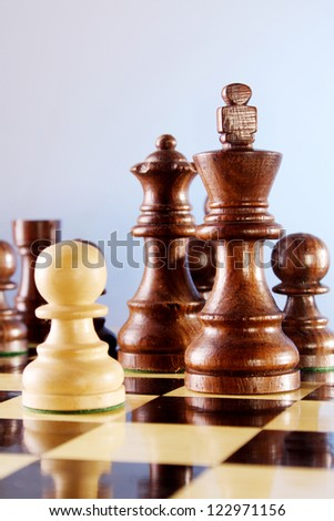 Chess game figure on board - stock photo