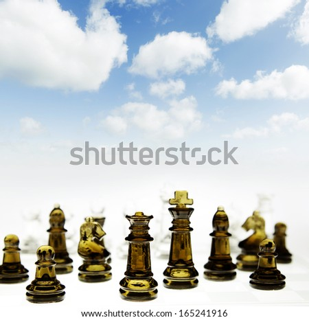 Chess game in front of blue sky - stock photo