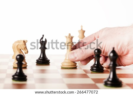 chess game,moving white chess queen n a chessboard - stock photo