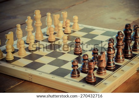 Chess game set with wooden chess pieces retro revival photography. - stock photo